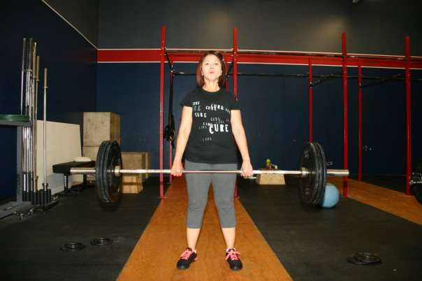 Ana, age 44, lifting 110lbs for the first time.