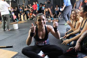 Mayra throwing two thumbs after the first workout