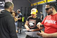 Quick pow wow with Coach EZ and Rosie of CrossFit Unexpected.